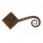 From The Anvil Monkeytail Lever Handles on Sprung Square Rose - Bronze