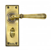 From The Anvil Newbury Bathroom Handles - Aged Brass